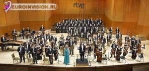 Испания: Премьера симфонической версии песни «Amanecer».